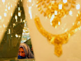 An Afghan Woman Looks for Gold at a Gold Shop Photographic Print