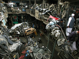 Afghans Shop for Used Car Parts at At an Auto Parts Market Photographic Print