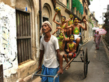 A Rickshaw Puller Carries Supporters of Brazil Soccer Team Reprodukcja zdjęcia