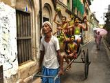 A Rickshaw Puller Carries Supporters of Brazil Soccer Team - Fotografik Baskı