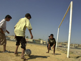 Iraqi Boys Play Soccer in a Baghdad Neighborhood Photographic Print