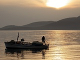Lone Fisherman Casts His Net at Twilight off the Adriatic Coast Photographic Print