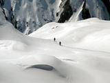 Two Mountain Hikers are Dwarfed by the Winter Landscape of the Formazza Valley Photographic Print