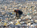 An Impoverished Mongolian Man Sorts Through Garbage at an Ulan Bator Dump Photographic Print