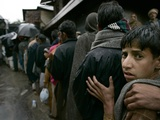 Pakistanis Wait in Line to Receive Food as Aid Photographic Print