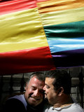 Supporters of Gay Marriage Hug Under a Multi-Coloured Flag Outside the Spanish Parliament Photographic Print