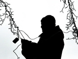 An Man Wires Christmas Lights Photographic Print