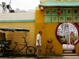 An Unidentified Chinese Man Walks Past the Cuban Wushu Association of Havana's Chinatown Photographic Print