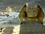 Tourists Stroll by Sphinx at the Historical Site of the Giza Pyramids, Near Cairo, Egypt Photographic Print