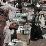 Afghan Money Changers on the Roadside Market Photographic Print