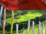 Praying Flags with Village and Farmlands at Pepe La Pass, Phobjikha Valley, Gangtey, Bhutan Photographic Print by Keren Su