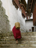 Monk Carrying Basket in Trongsa Dzong, Bhutan Photographic Print by Keren Su
