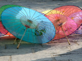 Umbrellas For Sale, China Photographic Print by Bruce Behnke