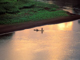 Sunset on Karo Men in a Dugout Raft, Omo River, Ethiopia Photographic Print by Janis Miglavs