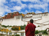 Tibetan Monk with Potala Palace, Lhasa, Tibet, China Photographic Print by Keren Su