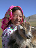 Tibetan Girl Holding Sheep in the Meadow, East Himalayas, Tibet, China Photographic Print by Keren Su