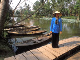 Woman Near Old Boats, Mekong Delta, Vietnam Photographie par Bill Bachmann