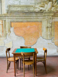 Table and Wall at 15th century Sedile Dominova Social Club, Sorrento, Campania, Italy Photographic Print by Walter Bibikow