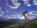Mountain Biker at Sunset, Canmore, Alberta, Canada Reproduction photographique par Chuck Haney