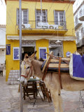 Donkey and Yellow Building, Hydra, Greece Photographic Print by Ali Kabas