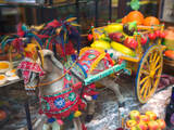 Miniature Sicilian Horsecart and Marzipan Candy, Corso Umberto 1, Taormina, Sicily, Italy Photographic Print by Walter Bibikow