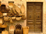 Montalcino, Basket Seller and Wall, Tuscany, Italy Photographic Print by Walter Bibikow