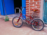 Children&#39;s Bicycle in Puerto Vallarta, The Colonial Heartland, Mexico Photographic Print by Tom Haseltine