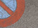 Closeup of Symbol Painted on Asphalt Photographic Print