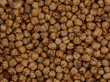 A Large Pile of Round Brown Nuts Photographic Print