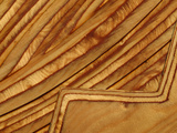 Close-up of Smooth Detail Lines Carved into a Piece of Wood Photographic Print