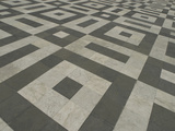 A Tiled Floor with a Dark and Light Gray Square Pattern Photographic Print