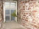 Brick Hallway with Door Overlooking the Ocean Photographic Print