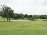 A Golf Course with a Pond Photographic Print