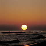 Yellow Sun in Sunset Over Ocean Waves Photographic Print