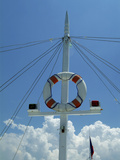 Sailboat Mast and Life Preserver Against Sky Photographic Print