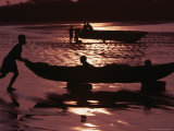 Man Pushing Dug-Out Canoe to Water's Edge with Two Children on Board, Esmeraldas, Ecuador, Photographic Print