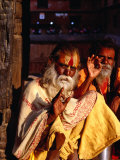 Portrait of Two Sadhus Making Hand Signals in Taumadhi Square, Bhaktapur, Nepal Photographic Print by Ryan Fox