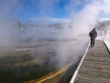 People Walking Boardwalk Over Hot Springs of Black Sand Basin, Yellowstone Nat. Park, Wyoming, USA Photographic Print by Stephen Saks