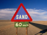 Warning Sign on Road Through Desert Namib Desert Park, Hardap, Namibia Photographic Print by John Borthwick