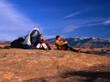A Couple Camping on Slickrock in Moab, Utah, USA Photographic Print by Cheyenne Rouse