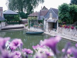 Cottage and Boathouse Along Waterfront Photographic Print