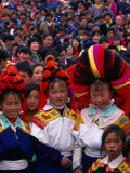 Miao Flower Girls in Traditional Costume Standing in Crowd, Nankai, China Photographic Print by Keren Su