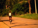 Boy Riding Bike on Dirt Road, Ko Samui, Surat Thani, Thailand Photographic Print by Dallas Stribley