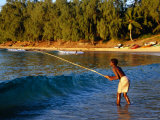 Boy Fishing off Beach, Tofo, Mozambique Fotografisk tryk af Pershouse Craig