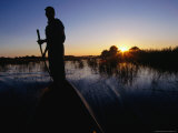 Safari Guide Standing in Boat at Sunset, Ngamiland, Botswana Photographic Print by John Borthwick