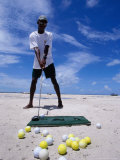 Bahamian Golfer Tees Up on the Pink Sand, Pink Sands Beach, Harbour Island, Bahamas Photographic Print by Greg Johnston