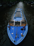 Blue Canal Tour Boat on Canal, Amsterdam, North Holland, Netherlands Photographic Print by Martin Moos