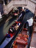 Overhead of Gondolier and Passangers in a Narrow Canal, Venice, Italy Photographic Print by Ryan Fox