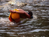 Novice Monk in River, Xieng Kok, Luang Nam Tha, Laos Photographic Print by Anders Blomqvist