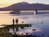 People on Shore with Boats Docked in Bay, Puerto Natales, Chile Photographic Print by Wayne Walton